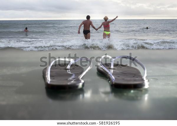 Beach. flip-flops. Couple