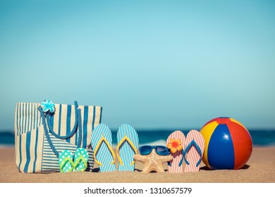 Beach flip-flops on the sand. Summer vacation concept