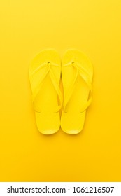 beach flip-flops on the yellow background. summer is concept