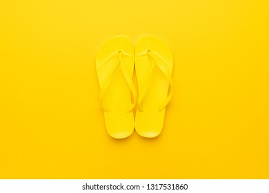 beach flip-flops on the yellow background. summer concept