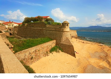 Beach and fortress of city of Ajaccio with tower, outer wards and walls,  Ajaccio, Corsica island (South), France