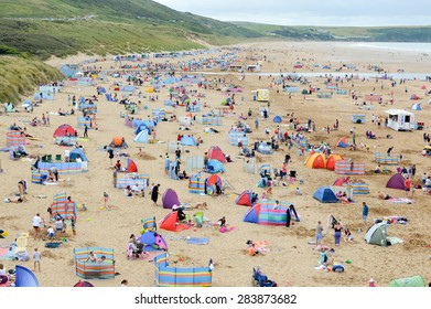 Beach full of tourists in summer in England