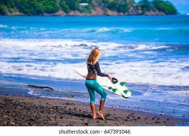 Beach Girls. Riding the waves. Costa Rica, surfing paradise