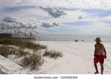 Beach goers on Lido Beach in Sarasota, FL