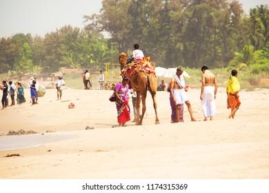 Beach in Gokarna. Indigenous people on the beach. Gokarna, Karnataka, India. Murch, 2016.