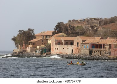 Beach of goree island in senegal with colored houses and boats. Goree is a landmark because of slaves market during the colonial period. The picture has been taken on 14th may 2016.