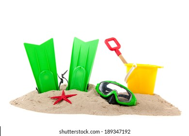 Beach with green diving equipment and yellow bucket