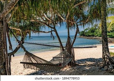 Beach hammock, relax in the shade and enjoy the ocean breeze while looking out over the blue ocean from your own private beach.