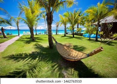 Beach hammock under palm tree by the sea at Koh Lipe Thailand
