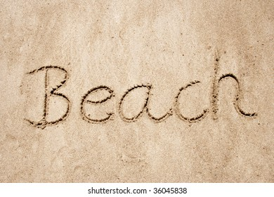 beach handwritten in sand for natural, symbol,tourism or conceptual designs