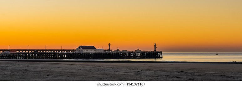 the beach harbor of Blankenberge, belgium, Sunset with colorful sky, architecture of the belgian coast