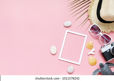 Beach hat, coconut leaves and glasses on pink background In the summer Asia,copy space,Top view,minimal style