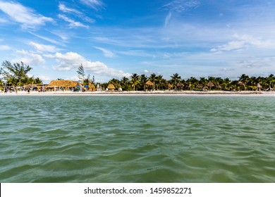 The beach of Holbox Island in Mexico viewed from the ocean