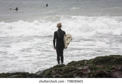 Beach holiday surfer staring