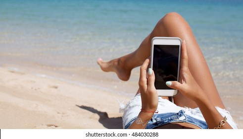 Beach holiday woman taking video with smart phone. Summer vacation.