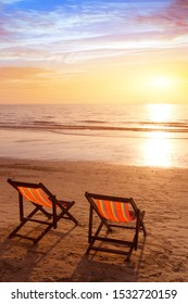 beach holidays vertical background, romantic getaway vacation on tropical sea coast, two deckchairs in hotel for couple