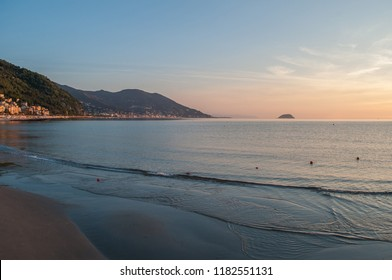 beach and horizon at dawn in Liguria