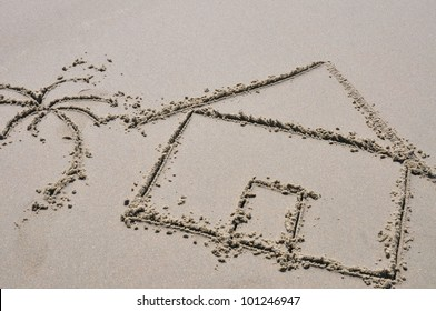 Beach house concept drawn in the sand