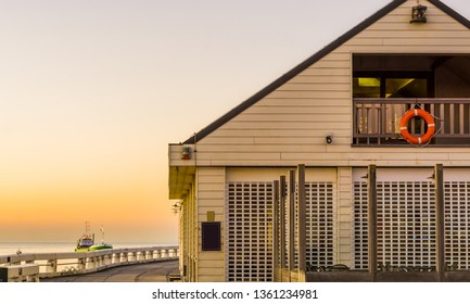 Beach house on the jetty of Blankenberge, Belgium, Architecture of the Belgian coast during sunset