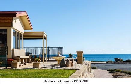 Beach house on seashore cost on a sunny day