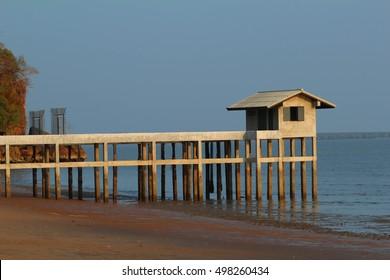 A beach house with sunset
