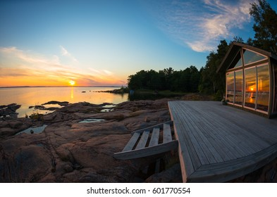 Beach house terrace at summer sunset