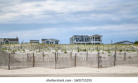 Beach houses along the sea shore on sand dunes,