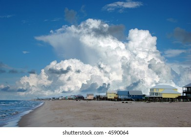 Beach houses in Gulf Shores, Alabama; with cumulus clouds in the background