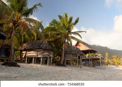 Beach houses with palms, fales, faleo'o in Faofao beach, Lepa, Upolu, Samoa.