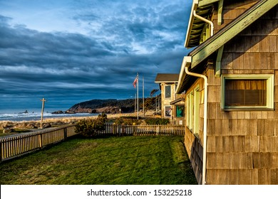 Beach houses at sunset in golden light. Location: Cannon Beach, Oregon, USA