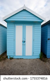 beach hut by the sea painted in light blue and white