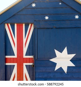 Beach hut painted in the Australian flag.