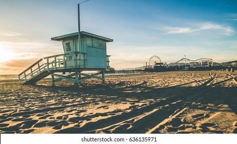 Beach hut with Santa Monica Pier in the background