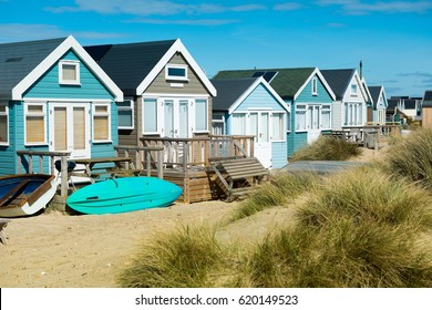 Beach huts and boats  at Mudeford Spit on Hengistbury Head ,England
