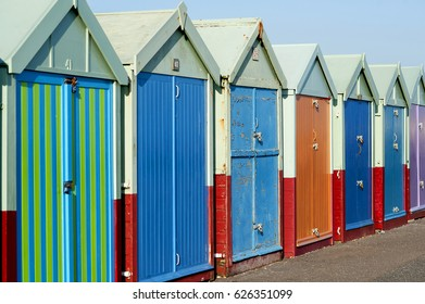 Beach huts, Brighton and Hove, Sussex, U.K., 2017. Colorful beach huts on the seafront in Brighton and Hove, England, are rented out and bought by local residents to enjoy on the promenade in Hove.