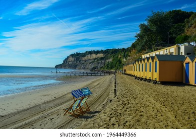Beach Huts and deckchairs at empty Shanklin Seafront, Isle of Wight. UK