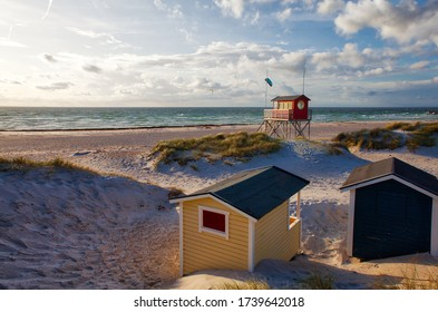 beach with huts and lifeguard