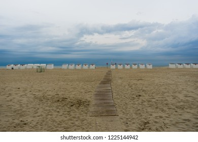 Beach huts on Belgian North Sea coast West Flanders Belgium in early morning