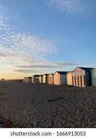 Beach huts on sandy beach in lancing