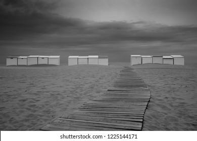 Beach huts in Oostduinkerke West Flanders Belgium - black white