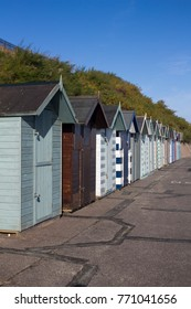 Beach huts at Pakefield, Suffolk, England, against a blue sky