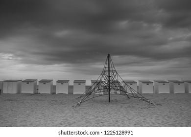 Beach huts and playground at Koksijde West Flanders Belgium - black white