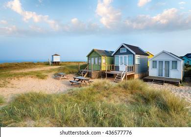 Beach huts in sand dunes on Mudeford Spit near Christchurch on the Dorset coast
