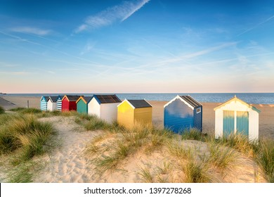 Beach huts in sand dunes at Southwold on the Suffolk coast