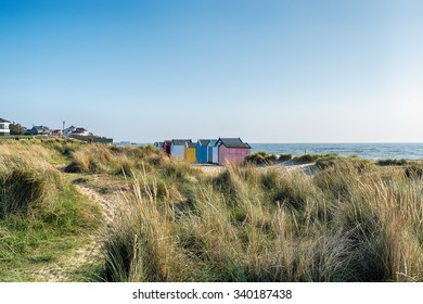 Beach huts and sand dunes at Southwold on the Suffolk coast