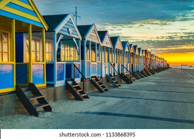 Beach huts at Southwold, Suffolk, England, at sunrise.