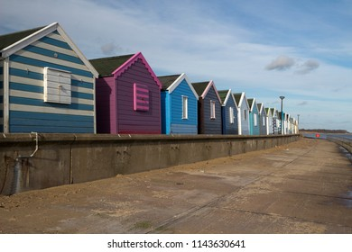 Beach huts at Southwold, Suffolk, England, against a blue sky
