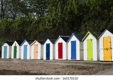 Beach Huts at Torquay, Sussex, UK.