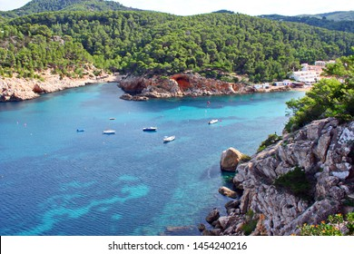 Beach of Ibiza, Balearic Islands, turquoise blue sea, Mediterranean sea, favorite destination of foreign tourists in Spain Typical views of holiday landscapes of Ibiza.