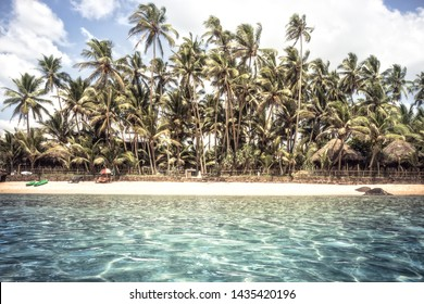 Beach island coastline palm trees  turquoise water summer vacation vintage background with palm trees surf sea as travel tropical lifestyle
